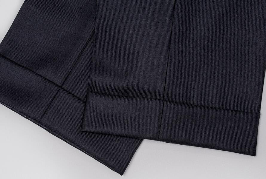 Blå kostymbyxor med slag